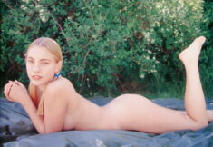 Young blonde nudist beauty